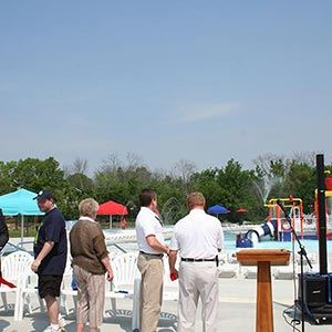 Group at Ribbon Cutting Ceremony Looking at Pool Area