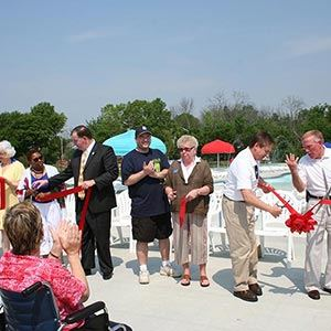 Individuals Enjoying Ribbon Cutting Ceremony