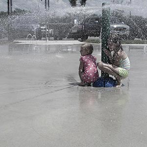 Young Children Enjoying Water Pole Area