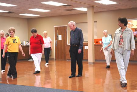 Various Individuals Enjoying a Dance Activity at the Huber Heights Senior Center